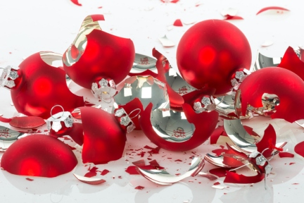 Broken Christmas balls over a white background